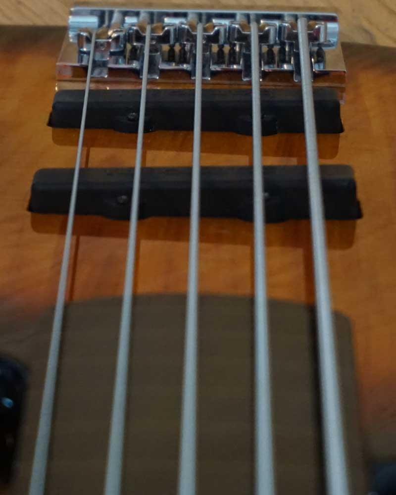 Closeup of electrib guitar workings and strings